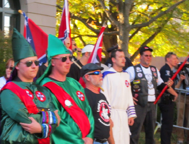 James Moore, far left, of the LWK at a rally with the neo Nazi National Socialist Movement in Charlotte, North Carolina in November 2012, while the head of the LWK was working full time with the FBI Joint Terrorism Task Force