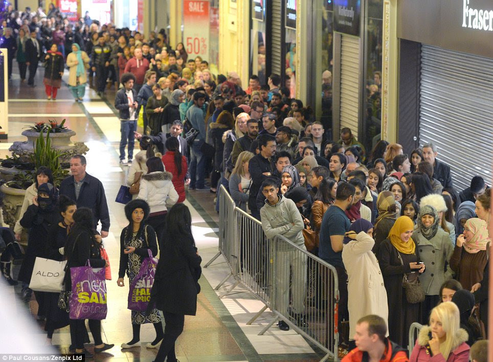 Crush: Shoppers queue up inside Manchester's Trafford Centre to try and get in to Selfridges