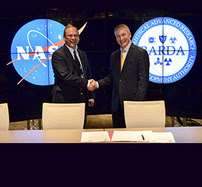 NASA and BARDA leadership share a handshake.