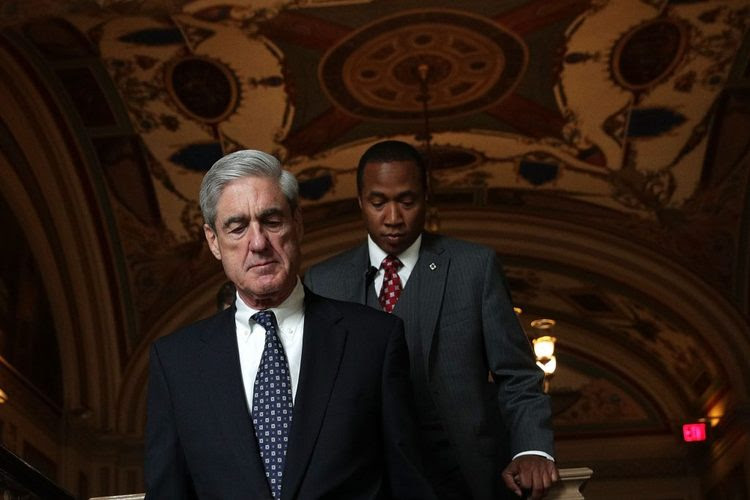 Special counsel Robert Mueller, left, at the Capitol on June 21. (Alex Wong/Getty Images)</p>