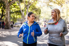 Image of two women engaging in physical activity outdoors.