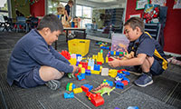 Two young boys playing with blocks