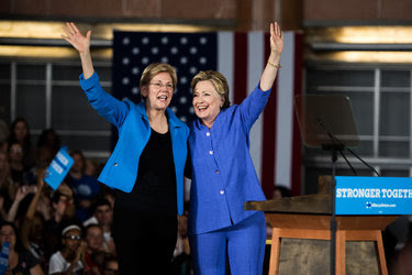 "Hillary Clinton, the presumptive Democratic presidential nominee, and Senator Elizabeth Warren of Massachusetts were greeted by a crowd holding up ""Girl Power"" signs at a ampaign rally in Cincinnati on Monday."