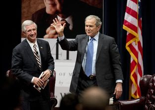 Former Chief of Staff Andrew Card, l, watches at George W. Bush acknowledges applause at the Bush Library on Nov. 11, 2014.