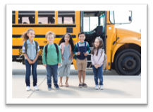 Photo of kids in front of a bus