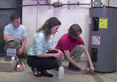 People testing water in a water heater