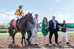 (L-R): Lady Aurelia and John Velazquez are led to the winner's circle by Peter Leidel, Barbara Banke, and Wesley Ward after the 2017 Giant's Causeway at Keeneland