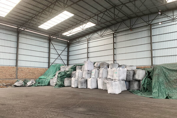 Sacks of coal byproducts await sale at a manufacturing site in northwestern China's Ningxia region, where Benjamin Chen works as a salesperson.