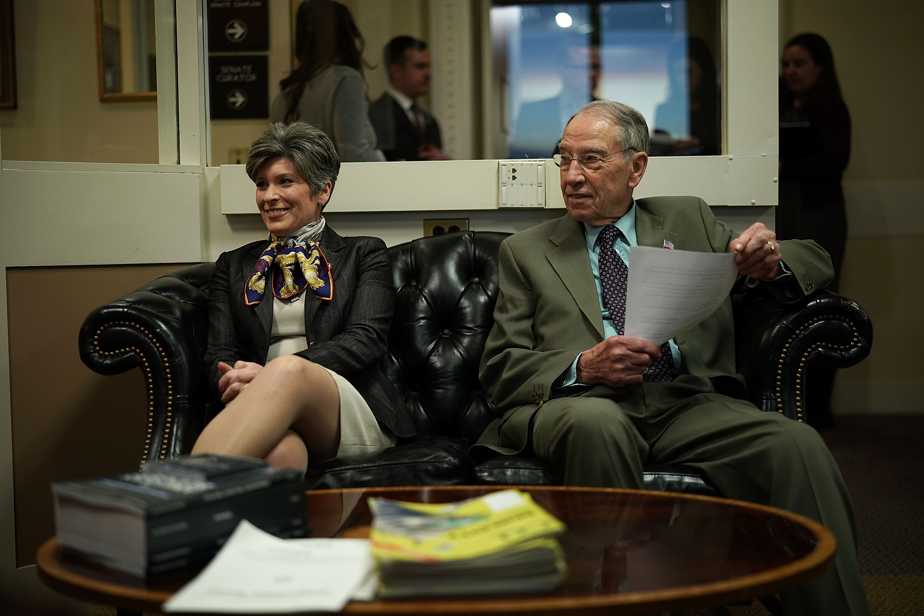 U.S. Sens. Chuck Grassley (R) and Joni Ernst wait for the beginning of a news conference on immigration February 12, 2018 at the Capitol in Washington, DC. (Photo by Alex Wong/Getty Images)