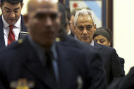 Mayor Rahm Emanuel of Chicago on his way to a City Council meeting on Wednesday. He told reporters he opposed the idea of sending in the National Guard.