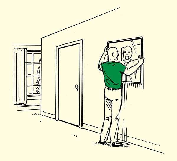 man placing mirror on wall in home illustration