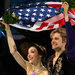 Meryl Davis and Charlie White of the United States took a victory lap around the ice after they won the gold medal in ice dancing at the Sochi Olympics.