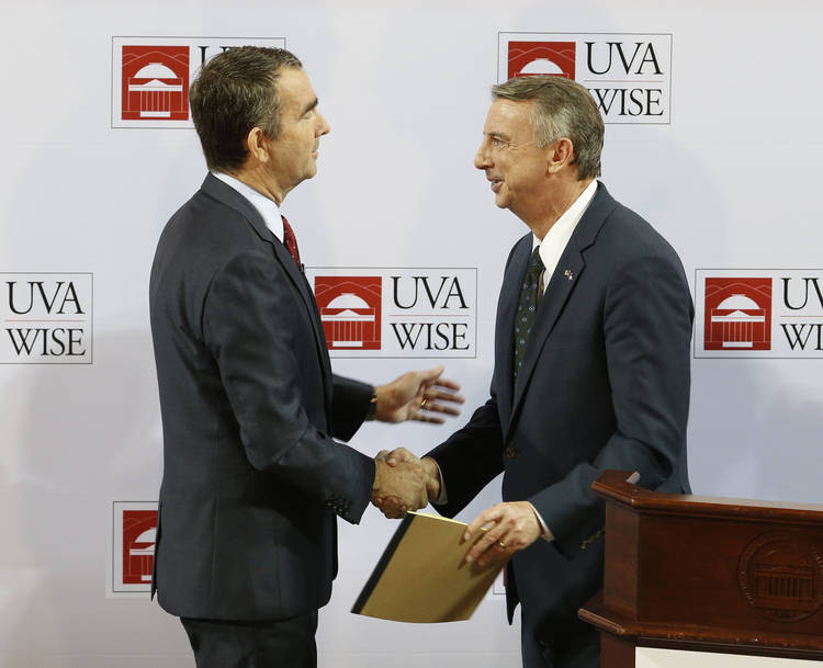 Virginia Lt. Gov. Ralph Northam, the Democratic candidate for governor, shakes hands with Republican challenger Ed Gillespie after a debate at the University of Virginia campus in Wise, Va., on Monday night. (Steve Helber/Associated Press)