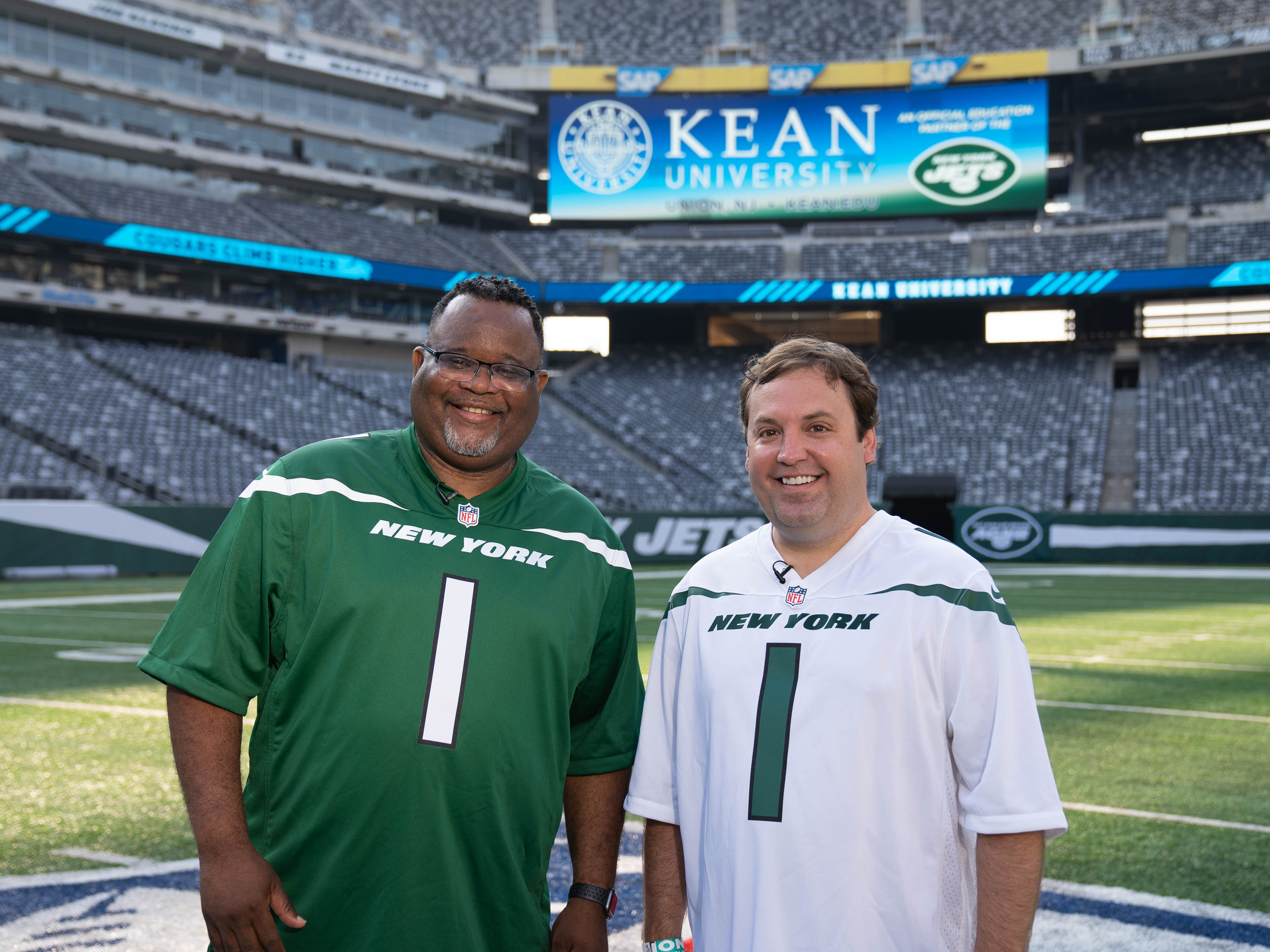 Kean University President Lamont O. Repollet, Ed.D., and Kean Foundation CEO Bill Miller on the field at MetLife Stadium.