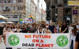 FILE PHOTO: People hold a banner during a protest march to call for action against climate change, as the spread of the coronavirus disease (COVID-19) continues, in Vienna, Austria, June 26, 2020. REUTERS/Leonhard Foeger/File Photo