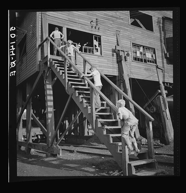 Children playing around old coal tipple. Scotts Run, West Virginia