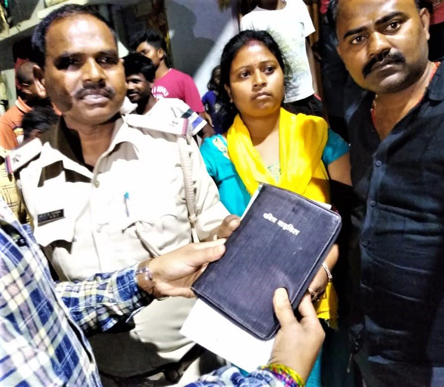 Villagers hand Bible to police in Lalpur as evidence against Christians in Ranchi, Jharkhand state, India. (Morning Star News)
