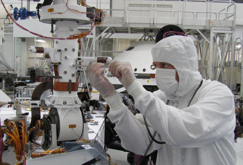 Installing one of the two mini-booms on the rover Curiosity that will monitor weather conditions on Mars, NASA's Jet Propulsion Laboratory, 2010.