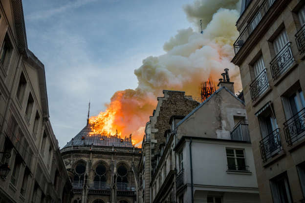 Slide 16 of 31: Smokes and flames rise during a fire at Notre-Dame Cathedral in central Paris, France, on April 15, 2019.- A fire broke out at the landmark Notre-Dame Cathedral in central Paris, potentially involving renovation works being carried out at the site, the fire service said. (Photo by Nicolas Liponne/NurPhoto via Getty Images)