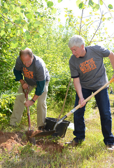 Creagh and Snyder plant trees at GEMS trail