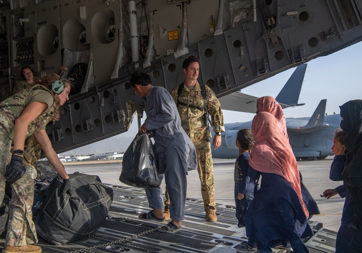 Refugees boarding a military plan in Kabul