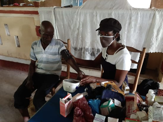 HAITIAN work in isolated Covid regions only with headmask as protection against Covid.jpg