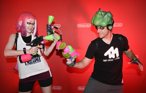 In this photo provided by Nintendo of America, cosplayers Heidi O'Ferrall and Leo Camacho celebrate  ...
