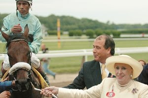 Marylou Whitney, followed by John Hendrickson, leads Birdstone to the winner's circle after the 2004 Belmont Stakes