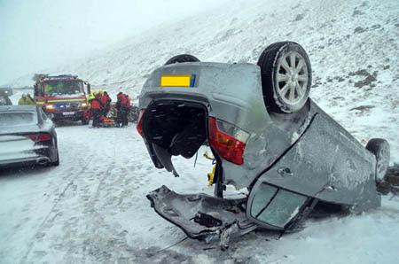 The overturned car on the Kirkstone Pass. Photo: Langdale Ambleside MRT