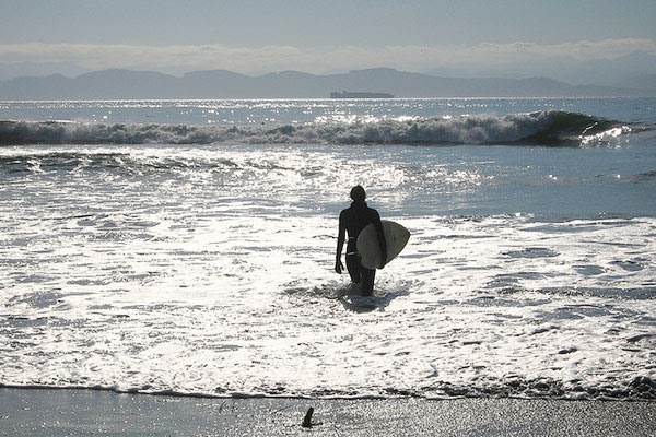 Surfer on coast. Credit: Tourism Victoria, Bonnie Benoit