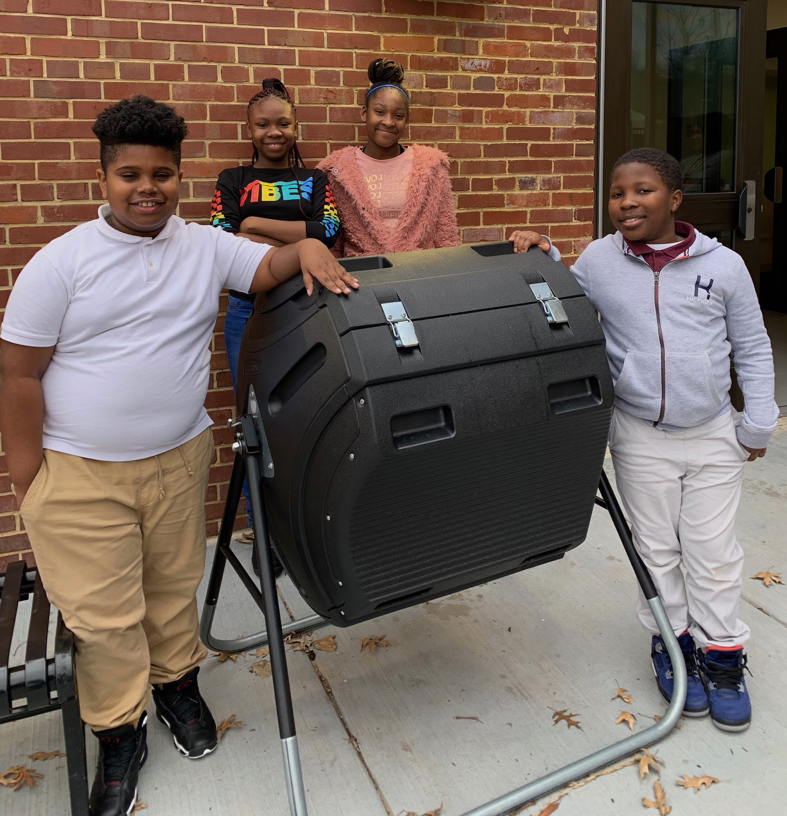 C. W. Harris students standing with a compost bin purchased with EcoRise Eco-Audit Grant funds.