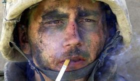 A member of Charlie Company of the U.S. Marines First Division, Eighth regiment, smokes a cigarette in Fallujah, Iraq, Tuesday, Nov. 9, 2004. U.S. forces punched into the center of the insurgent stronghold, overwhelming bands of guerrillas in the street with heavy barrages of fire and searching house to house in a powerful advance on the second day of a major offensive. (AP Photo/Los Angeles Times, Luis Sinco) ** MANDATORY CREDIT, NO SALES, NO FOREIGN, NO MAGS, LOS ANGELES DAILY NEWS OUT, OC REGISTEROUT, VENTURA COUNTY STAR OUT, INLAND VALLEY DAILY BULLETIN OUT, SAN BERNARDINO SUN OUT **