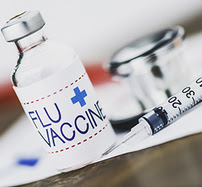 flu vaccine bottle and syringe