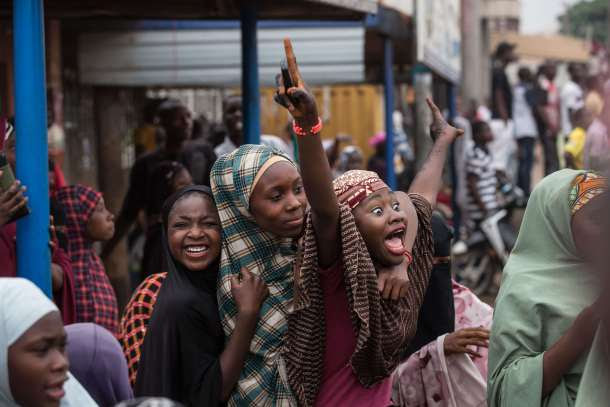 -- AFP PICTURES OF THE YEAR 2015 -- Hundreds of Nigerians celebrate at an intersection in the flashpoint northern city of Kaduna on March 31, 2015 the victory of main opposition All Progressives Congress (APC) presidential candidate Mohammadu Buhari. AFP PHOTO / NICHOLE SOBECKI
