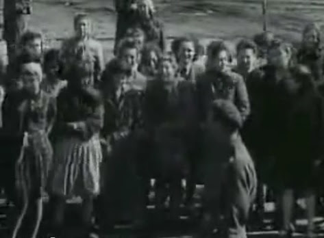 Public with emotions watching the lorry                             full of emaciated dead bodies coming                             probably from the Rhine meadow camps (12min.                             48sec.)