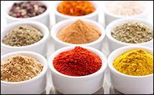 The figure shows containers of various spices for cooking.