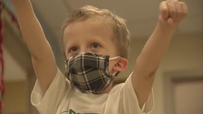 Little boy dances after finishing chemotherapy