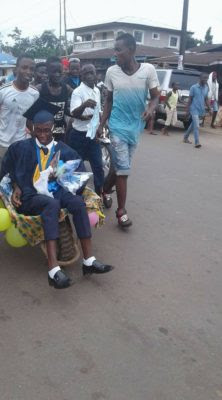 Photos: Pure Water Seller Celebrated With A Wheelbarrow Ride, By His Friends In Celebration As He Graduates From School