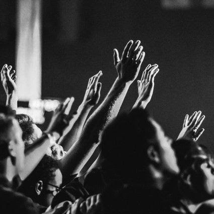 Group with hands raised in worship