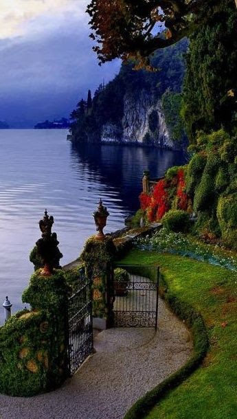 Gate opens to Lake Como, Italy.