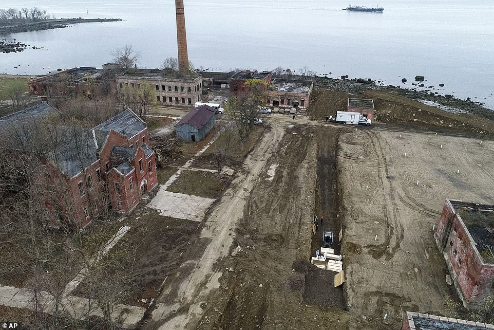The mass grave was dug last week and stretches along a lengthy portion of the island