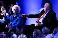 Former President George Bush and his wife, Barbara, at the Republican debate in Houston in February.