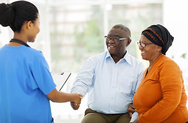 A senior couple consulting with a nurse.