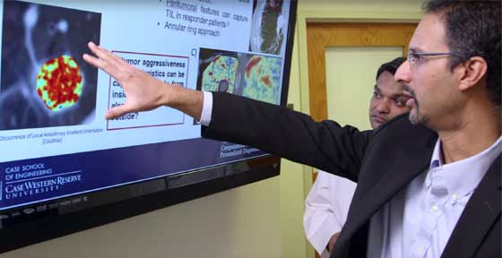 CWRU Professor Anant Madabhushi showing a colleague images on a screen