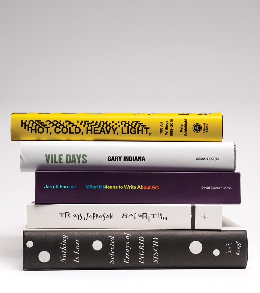Five books of art criticism in a stack (titles listed in text)