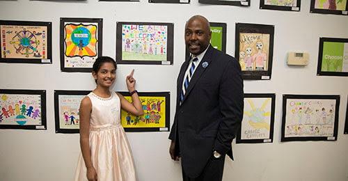 Hanover Hills student Joshitha Sriperambudur and Principal Troy Todd.
