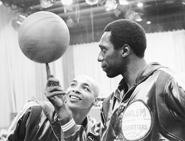 "Fred ""Curly"" Neal (left), shown here with fellow Globetrotter Meadowlark Lemon, has died at age 77."