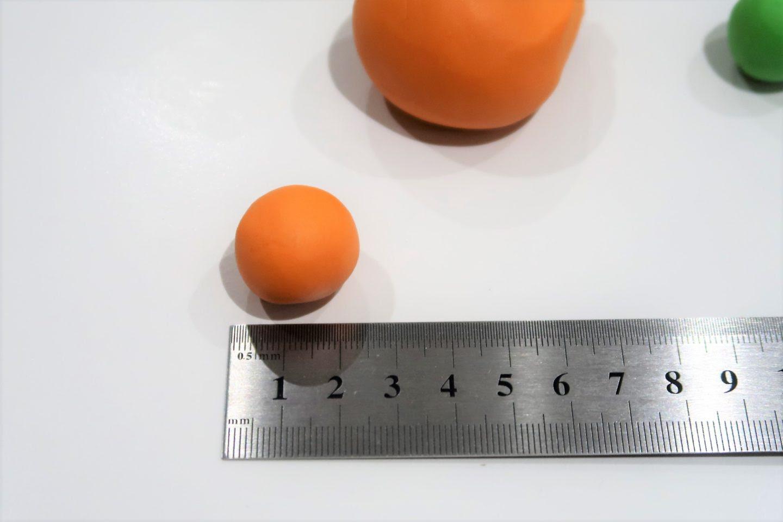 Ruler measuring carrot.