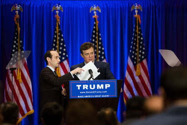 Paul Manafort, center, the campaign chairman for Donald J. Trump, and Stephen Miller, a speechwriter, in June. Mr. Manafort will retain his title but the staffing change is a demotion for him.