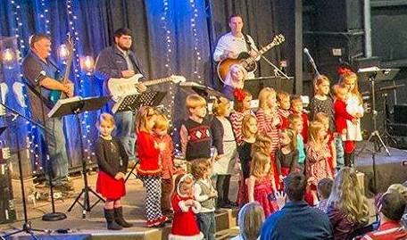 Christmas Choir singing on stage at Shelby Crossings.